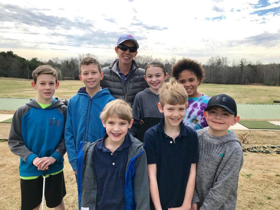 Coach Sandy Halkett and junior students at Haas Family Golf